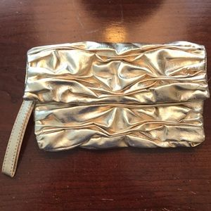 Express gold clutch